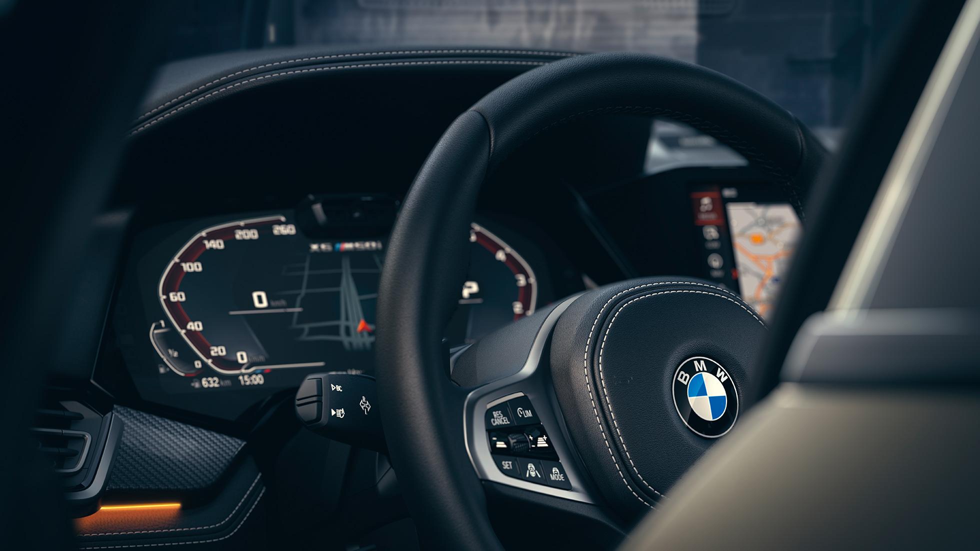 Imagine în prim-plan cu interiorul BMW X6 cu panou de instrumente.